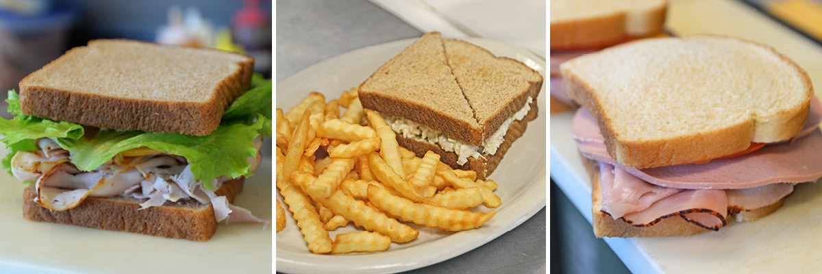 Three sandwiches options – turkey, chicken salad with fries, and a baloney sandwich.