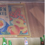 Two images displaying old Kellogg's Corn Flakes posters.